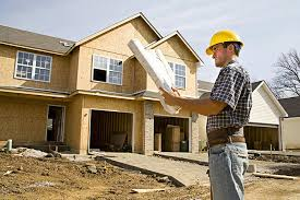 Custom homebuilder looking at the floor plan